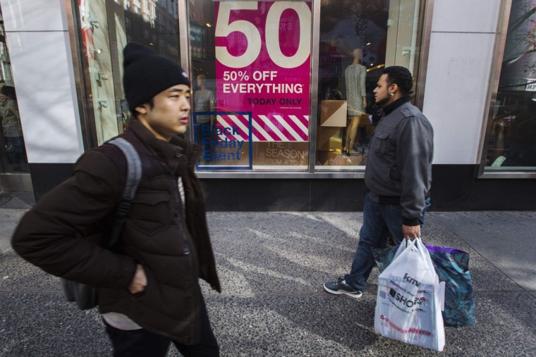 Pedestrians carry shopping bags as they walk down the street during Black Friday sales in New York, November 29, 2013. Black Friday, the day following Thanksgiving Day holiday, has traditionally been the busiest shopping day in the United States. (Lucas Jackson/REUTERS)