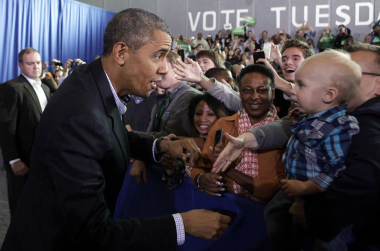 U.S. President Barack Obama greets the audience at a campaign event for Terry McAuliffe for Governor in Arlington, Virginia, November 3, 2013. (REUTERS/Yuri Gripas)