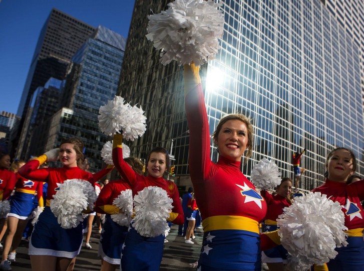 Cheerleaders walk down Sixth Avenue during the 87th Macy's Thanksgiving Day Parade in New York. (REUTERS/Eric Thayer)