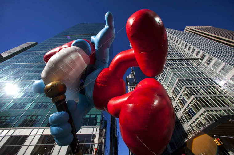 The Papa Smurf balloon floats down Sixth Avenue during the 87th Macy's Thanksgiving Day Parade in New York. (REUTERS/Eric Thayer)