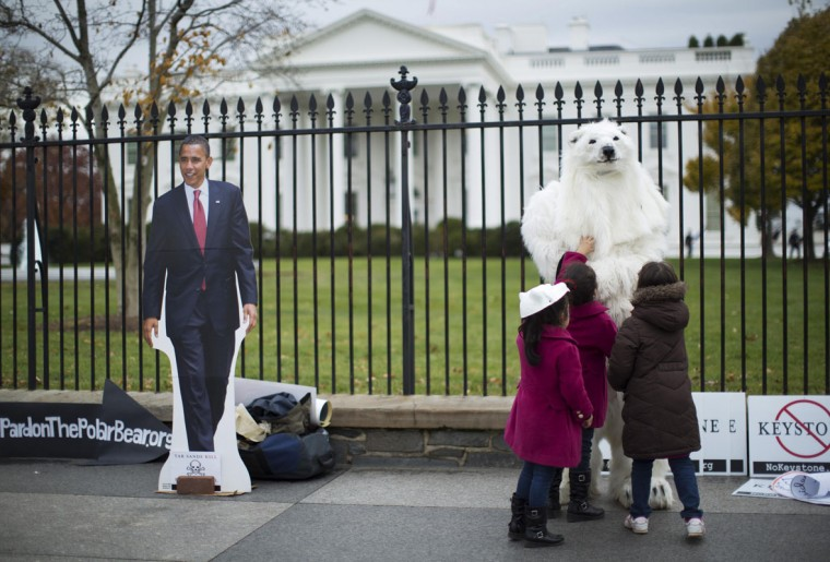 Children interact with a protester dressed as a polar bear against the Keystone XL oil pipeline project, as a cut-out of U.S. President Barack Obama is seen nearby outside the White House in Washington, November 22, 2013. TransCanada Corp has waited more than five years for the Obama administration to make a final decision on the controversial project, which will take oil from the Alberta oil sands and North Dakota's Bakken field as far as the Cushing, Oklahoma, storage hub. (REUTERS/Jason Reed)