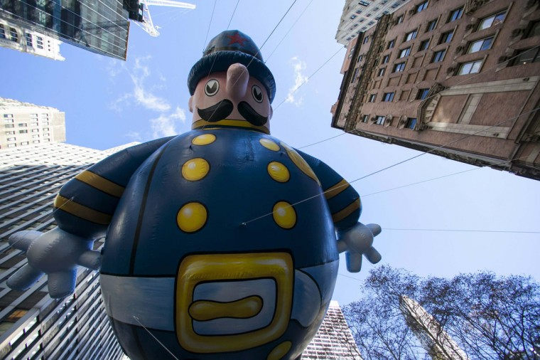 A Keystone Cop balloon floats down Sixth Avenue during the 87th Macy's Thanksgiving Day Parade in New York. (REUTERS/Eric Thayer)