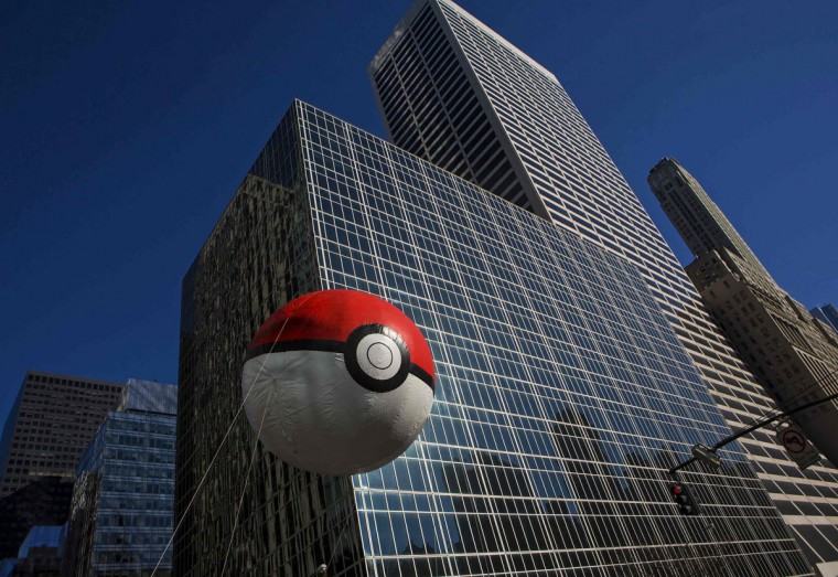 A Pokeball balloon floats down Sixth Avenue during the 87th Macy's Thanksgiving Day Parade in New York. (REUTERS/Eric Thayer)