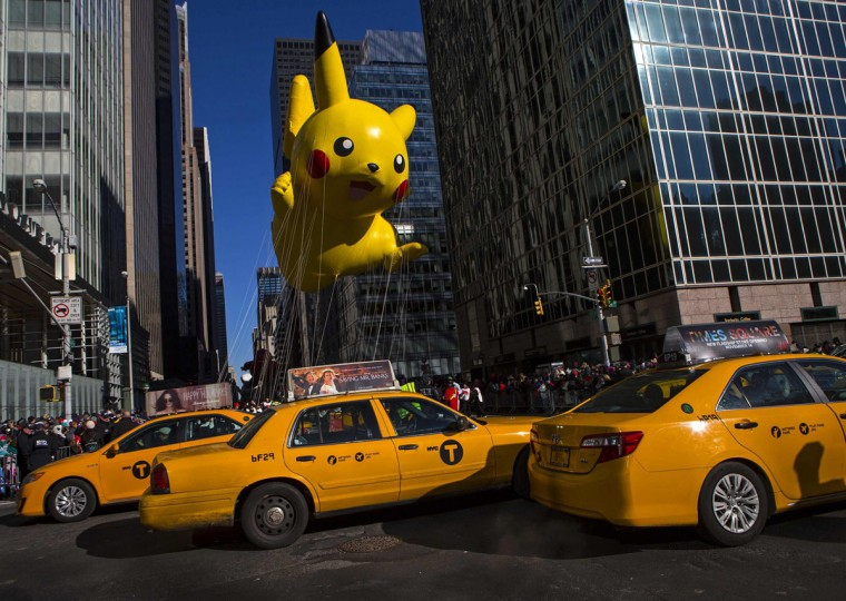 A Pikachu balloon floats down Sixth Avenue during the 87th Macy's Thanksgiving Day Parade in New York. (REUTERS/Eric Thayer)