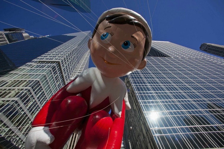 The Elf on the Shelf balloon floats down Sixth Avenue during the 87th Macy's Thanksgiving Day Parade in New York. (REUTERS/Eric Thayer)