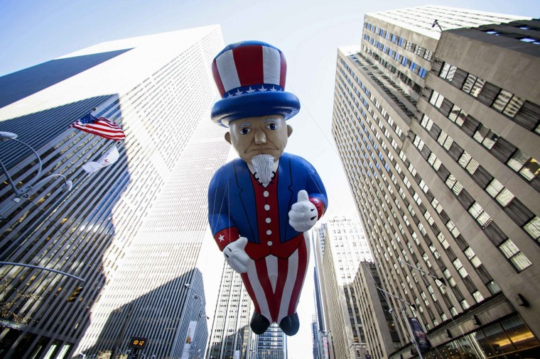 An Uncle Sam balloon floats down Sixth Avenue during the 87th Macy's Thanksgiving Day Parade in New York. (REUTERS/Eric Thayer)