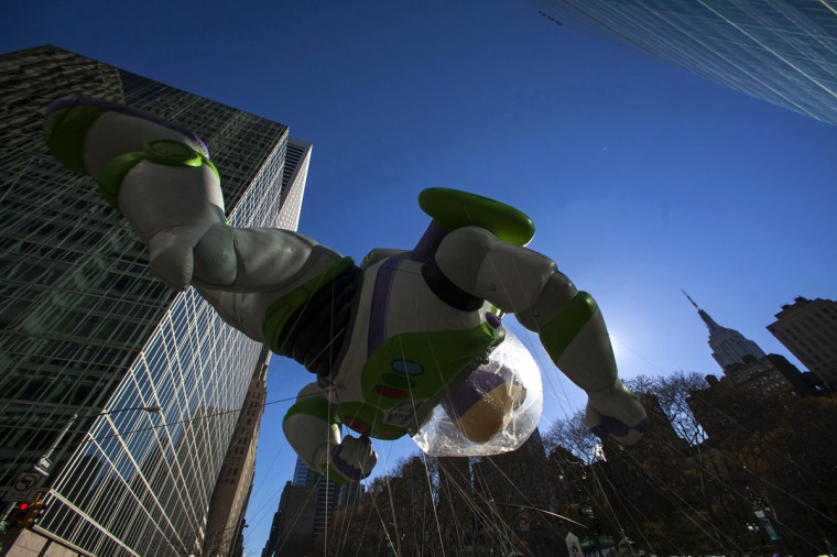 A Buzz Lightyear balloon floats down Sixth Avenue during the 87th Macy's Thanksgiving Day Parade in New York. (REUTERS/Eric Thayer)