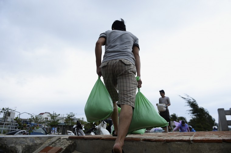 A resident collects sandbags to protect houses against Typhoon Haiyan in Vietnam's central Da Nang city, November 9, 2013. Authorities in 15 provinces in Vietnam have started to call back boats and prepare for possible landslides. Nearly 300,000 people were moved to safer areas in two provinces alone - Da Nang and Quang Nam - according to the government's website. (Duc Hien/REUTERS)