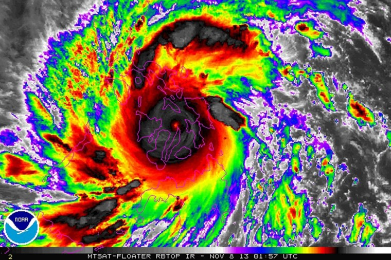 Typhoon Haiyan is pictured in this NOAA satellite image taken November 8, 2013 at 01:57 UTC. Haiyan, potentially the strongest recorded typhoon to make landfall, slammed into the Philippines' central islands on Friday, forcing millions of people to flee to safer ground or take refuge in storm shelters. (NOAA/Reuters)