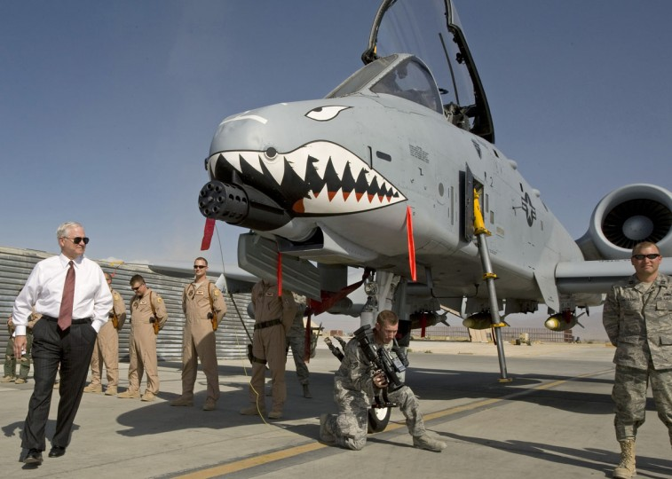 "U.S. Secretary of Defense Robert Gates (left) greets the crew and looks over an A-10 ""Warthog"", a close support aircraft, during an unannounced visit to Bagram Airfield September 17, 2008. (Paul J. Richards/Reuters)"