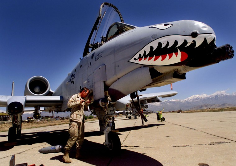 Staff Sergeant Keith Haas of the US Air Force adjusts equipment on a A-10 Warthog warplane at Bagram Air Base, north of Kabul April 17, 2002. The Pentagon on Tuesday identified four American soldiers killed in an explosion while blowing up suspected abandoned Taliban rockets near Kandahar in southern Afghanistan. (Peter Andrews/Reuters)