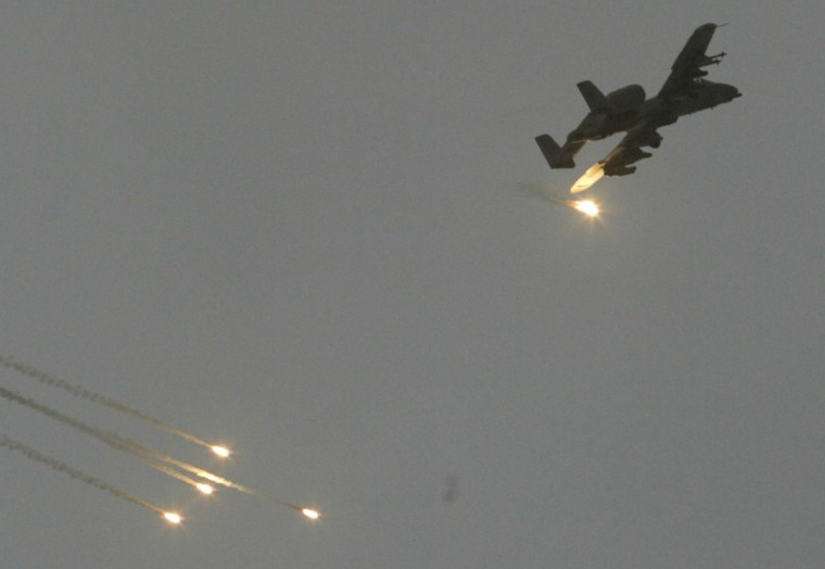 A U.S. A-10 Warthog drops flares to evade anti-aircraft artillery as it flies over Baghdad April 8, 2003. U.S. aircraft, artillery and tanks mounted an intense early-morning bombardment on Tuesday of an area in central Baghdad that houses a concentration of government ministries and other official buildings. (Faleh Kheiber/Reuters)