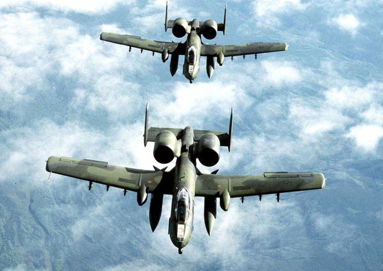 Two single-seat A-10 jets from Davis-Mothan Air Force Base in Tucson, Arizona collided and crashed in the southern Arizona desert on January 17, 2002, the Air Force said.] A pair of U.S. Air Force tank busting A-10A Thunderbolt II jets, also known as the Warthog, fly in this undated file photo.