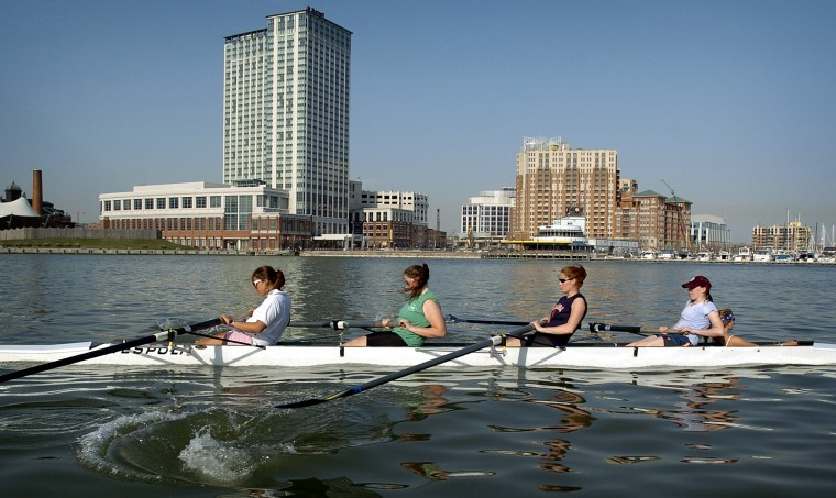 Carey Smith, center, who has received a rowing scholarship to Syracuse University. Also pictured are: (l-r) Marion Hashim, K.C. Burke, Carey Smith, Kaity Moss and Erica Collins during practice on the Inner Harbor. (Kenneth K. Lam/Baltimore Sun Photo/April 6, 2005)
