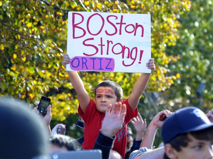 A fan of the Boston Red Sox holds a sign during the World Series parade and celebration. (Bob DeChiara/USA TODAY Sports)