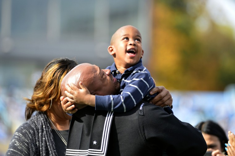 Petty Officer First Class Sharndell Ziglar holds up his three year old son, Matthew, as he surprises his family who did not no he would be attending the game at Kenan Memorial Stadium. Ziglar was recognized for his service in honor of Veterans Day. (Bob Donnan/USA TODAY Sports)