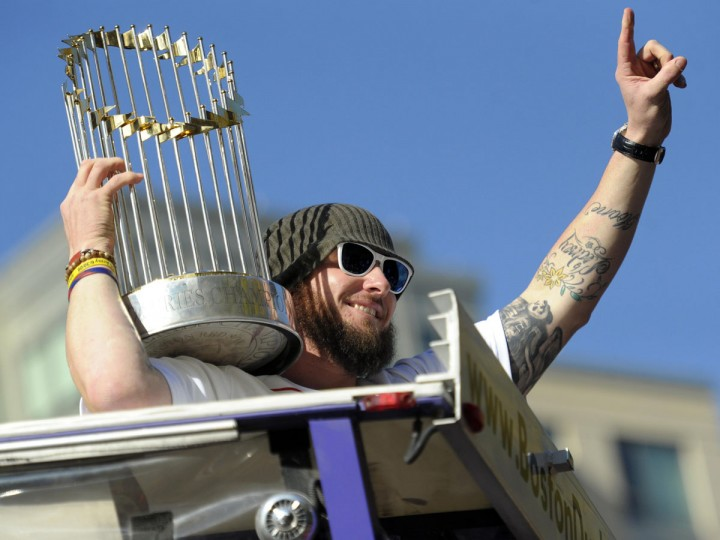Boston Red Sox catcher Jarrod Saltalamacchia holds the World Series trophy during the World Series parade and celebration. (Bob DeChiara/USA TODAY Sports