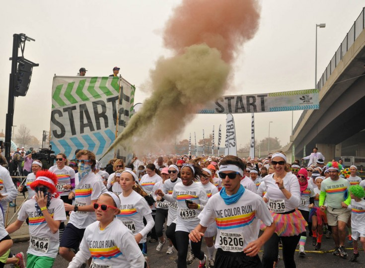 The runners take off at one of the starts in the morning Color Run. (Amy Davis /Baltimore Sun)