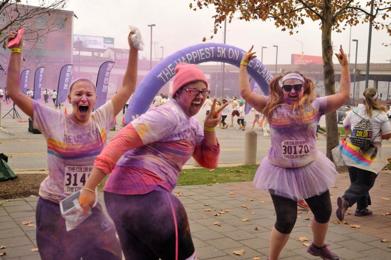 Runners show off their purple layer in the morning Color Run. (Amy Davis /Baltimore Sun)