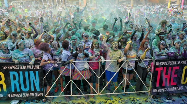 The painted crowd cheered at the celebration that followed the morning Color Run. (Amy Davis /Baltimore Sun)