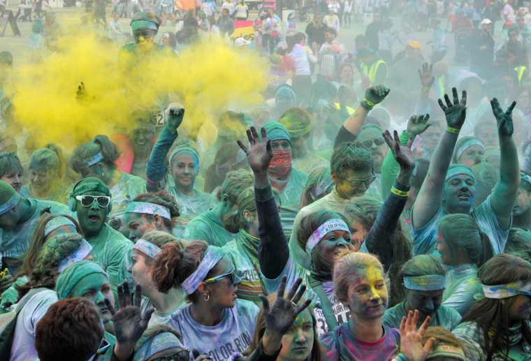 Participants celebrated after the run near the stage entertainment following the morning Color Run. (Amy Davis /Baltimore Sun)