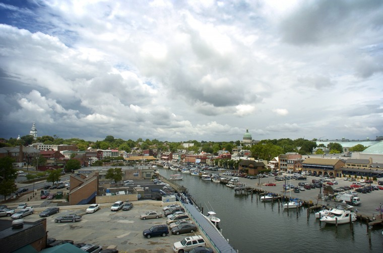 "Scenic view of the market slip in historic downtown Annapolis, sometimes known as ""Ego Alley."" The Statehouse is visible along the skyline at left, and the Naval Academy is at right. Photo was taken from the roof of the Annapolis Marriott Waterfront, where a new wireless weather station was being installed. The new equipment will provide more accurate and detailed information for boaters and residents. (Amy Davis/Baltimore Sun Photo/June 27, 2005)"