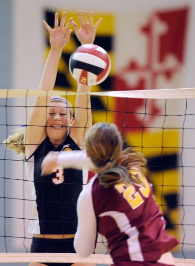 Dulaney's Darla Svoboda, left, blocks a hit from Hereford's Erin Collins in the Baltimore County volleyball championship match at Dulaney High School in Timonium. Dulaney won the match in three games. (Steve Ruark/For The Baltimore Sun)