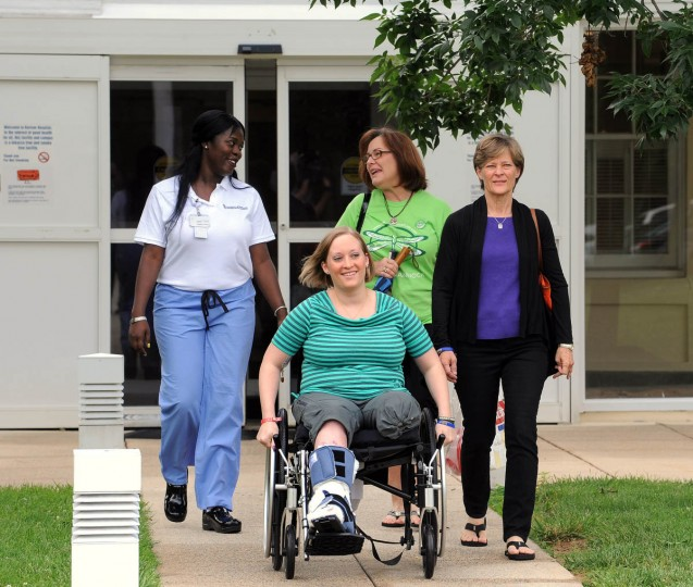 Erika Brannock is released from Kernan Orthopaedics and Rehabilitation to go home for the first time since she left for the Boston Marathon on April 12. With her from left are: Roetisha Hopkins, patient care technician; Erika's aunt, Debbie Atkinson, and Erika's mother, Carol Downing. (Algerina Perna/Baltimore Sun)