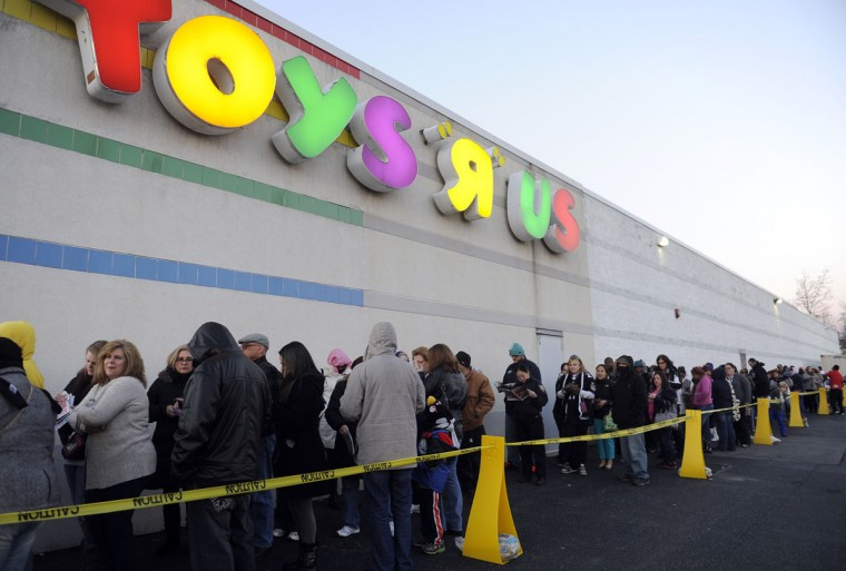 Thanksgiving shoppers wait in line and shop on Thanksgiving evening at Toys R Us. (Barbara Haddock Taylor/Baltimore Sun)