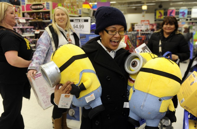 Rollice Roice Abuan of Allentown PA holds three minion dolls from the Despicable Me movie that she is buying at Toys R Us. She and several family members waited in line since 10 this morning in order to get the items they wanted. (Barbara Haddock Taylor/Baltimore Sun)