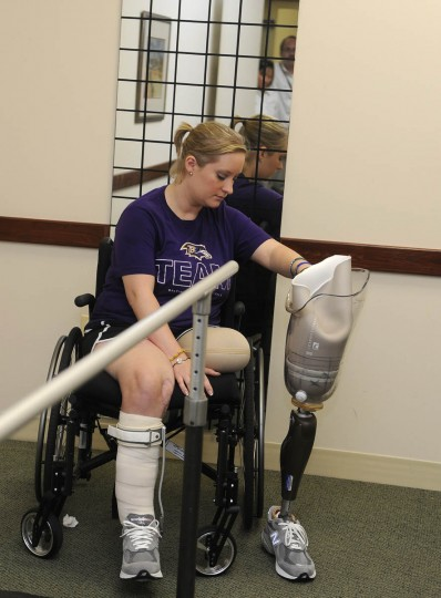 Erika Brannock looks at the prosthetic leg in one of the exam rooms. (Barbara Haddock Taylor/Baltimore Sun)