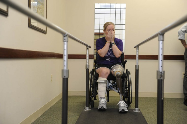 Erika Brannock gets emotional as she gets ready to stand on the new leg for the first time. (Barbara Haddock Taylor/Baltimore Sun)