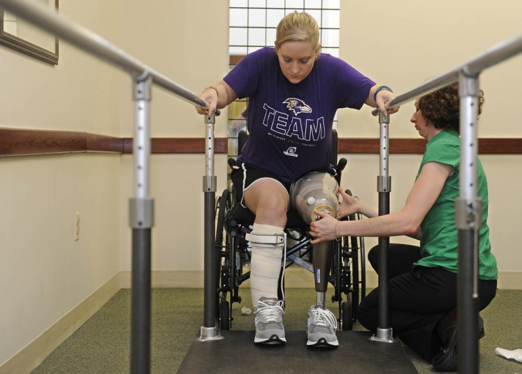 Erika Brannock concentrates as Angela Swindell, a certified prosthetist and orthotist, makes adjustments to the leg. (Barbara Haddock Taylor/Baltimore Sun)