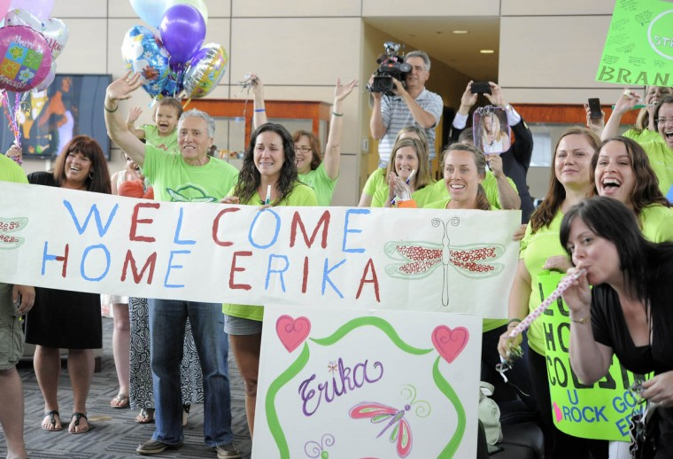 Boston bombing victim Erika Brannock returns home to Baltimore after seven weeks in the hospital. She is greeted by friends and family at Signature Aviation. (Lloyd Fox/Baltimore Sun)