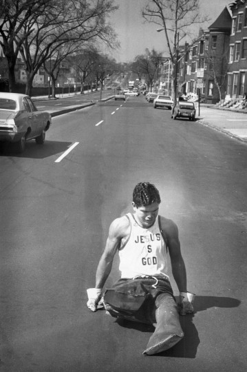 "3/28/1971 - Baltimore, MD - Marcher Gene Roberts, vvho lost both legs after stepping on a mine in Vietnam, was the first to cross the finish line in the 1971 March of Dimes walkathon. He spent about 16 hours dragging himself over the 25 mile route because, ""It means so much to other people."" Weyman Swagger/Baltimore Sun"