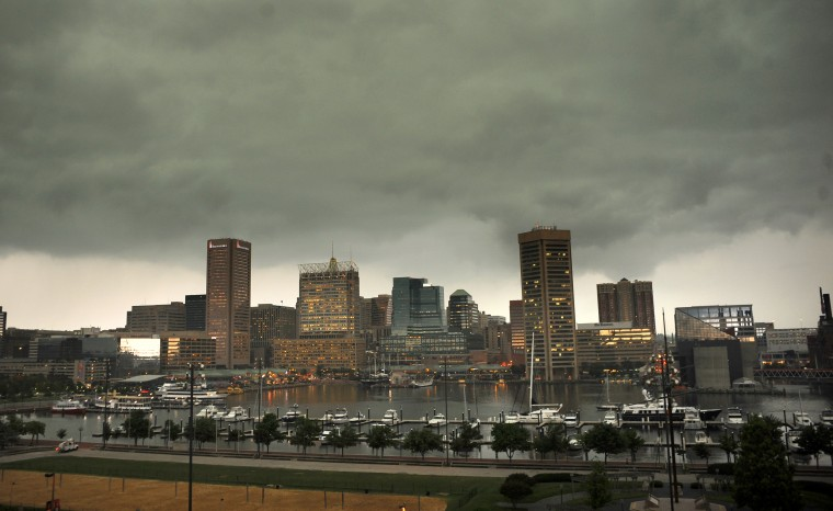 The Baltimore skyline is seen as a severe weather front moves in Thursday morning. (Jerry Jackson/Baltimore Sun/June 13, 2013)