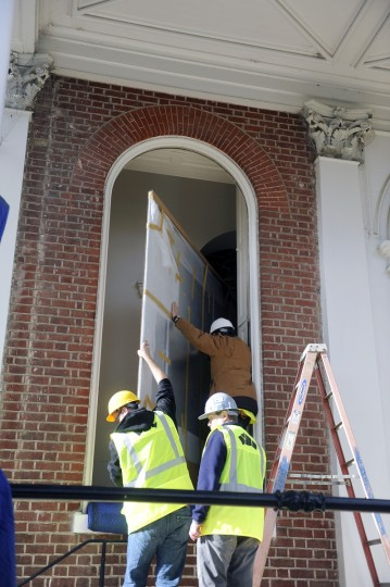 The painting was too large to be removed from any of the doors in the State House, so it was taken out through a window, which itself had to be taken out. (Barbara Haddock Taylor/Baltimore Sun)