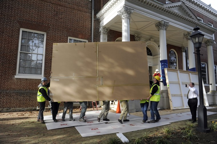 Professional art handlers remove the 1859 painting from the main stairwell at the State House. Because of the painting's size, it had to be removed from the State House through one of its first floor windows. (Barbara Haddock Taylor/Baltimore Sun)