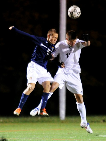 River Hill's Addison Testoff, left, and Urbana's William Eskay clash mid-air while trying to head the ball during the boys soccer 3A state semifinal match at the CCBC-Essex campus in Rosedale on Saturday, Nov. 9, 2013. (Jon Sham/BSMG)