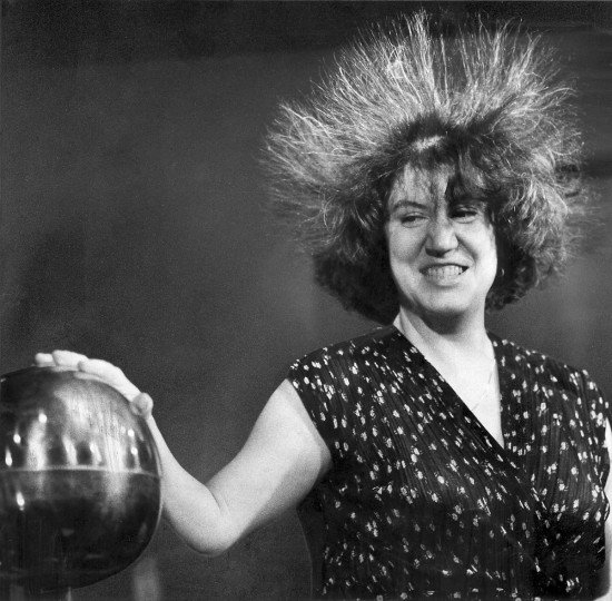 6/25/1981 - Baltimore, MD - Laura Hoopes volunteered for a demonstration of the effects of static electricity while attending a party at the Maryland Science Center. The most noticeable effect was the immediate change in her hairdo. (Weyman Swagger/Baltimore Sun)