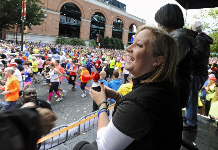 Honorary starter Erika Brannock, a survivor of the Boston Marathon terrorist bombing attack, smiles after she started the 2013 Baltimore Marathon during the 13th Annual Baltimore Running Festival. (Kenneth K. Lam/Baltimore Sun)