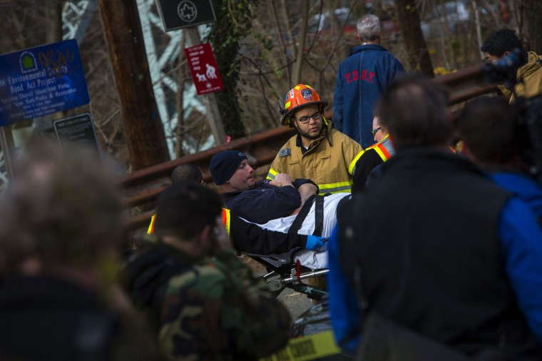 A man is taken away on a stretcher at the site of a Metro-North train derailment in the Bronx borough of New York December 1, 2013. At least four people were killed and 63 injured, including 11 critically, when the suburban train derailed, with at least five cars from the Metro-North train sliding off the tracks, officials said. (Eric Thayer/Reuters)