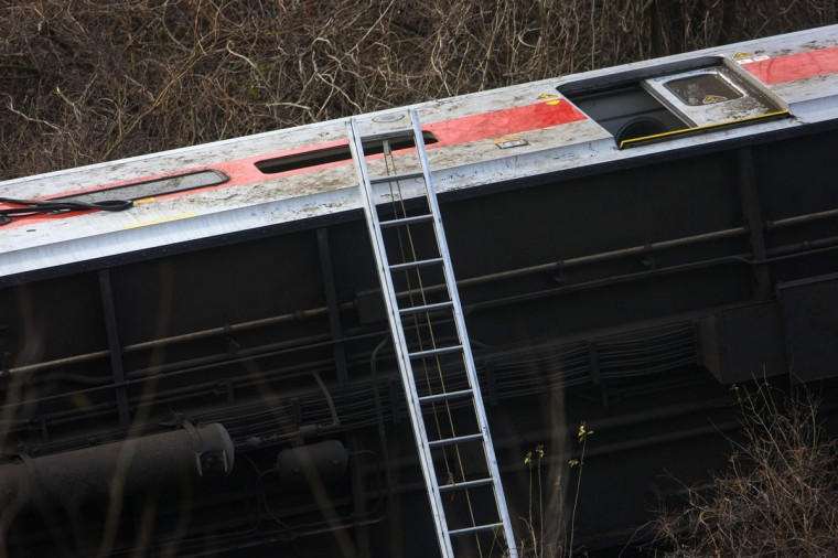 Overturned train cars are seen at the site of a Metro-North train derailment in the Bronx borough of New York December 1, 2013. At least four people were killed and 63 injured, including 11 critically, when the suburban train derailed, with at least five cars from the Metro-North train sliding off the tracks, officials said. (Eric Thayer/Reuters)