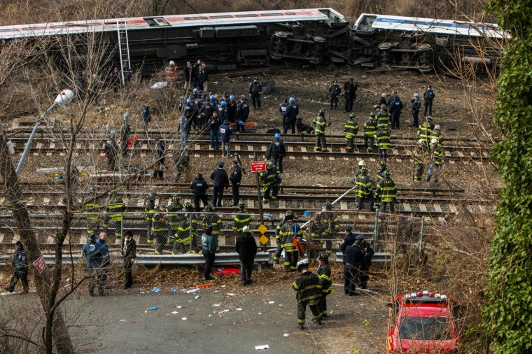 Emergency crews help injured passengers after Metro-North train derailed near the Spuyten Duyvil station December 1, 2013 in the Bronx borough of New York City. Multiple injuries and several deaths were reported after the seven car train left the tracks as it was heading to Grand Central Terminal along the Hudson River line. (Christopher Gregory/Getty Images)
