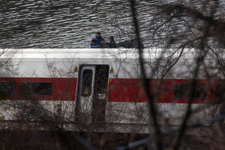 Police officers riding an inflatable boat look for victims of a Metro-North train derailment in the Hudson river in New York December 1, 2013. At least four people were killed and 63 injured, including 11 critically, when the suburban train derailed, with at least five cars from the Metro-North train sliding off the tracks, officials said. (Eric Thayer/Reuters)