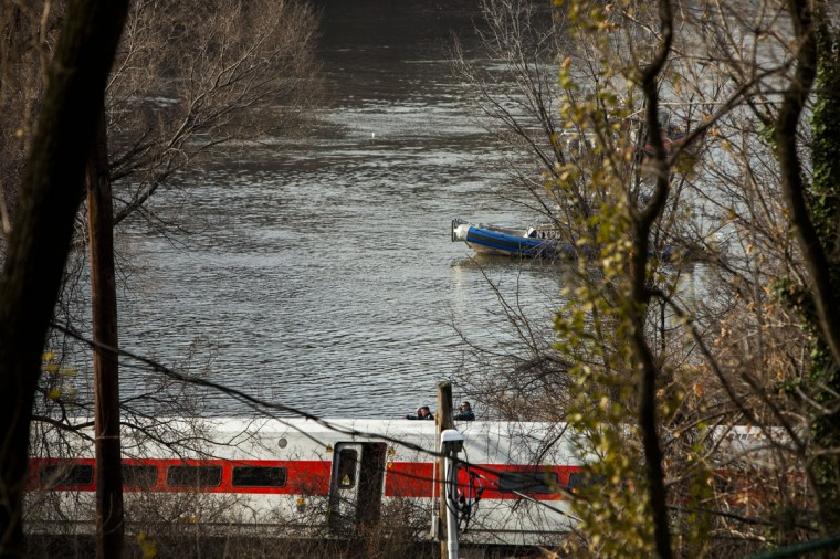 An New York Police Department boat passes as emergency crews respond after Metro-North train derailed near the Spuyten Duyvil station December 1, 2013 in the Bronx borough of New York City. Multiple injuries and several deaths were reported after the seven car train left the tracks as it was heading to Grand Central Terminal along the Hudson River line. (Christopher Gregory/Getty Images)