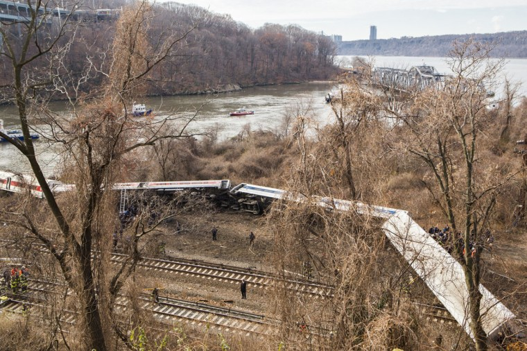 Emergency crews respond after Metro-North train derailed near the Spuyten Duyvil station December 1, 2013 in the Bronx borough of New York City. Multiple injuries and several deaths were reported after the seven car train left the tracks as it was heading to Grand Central Terminal along the Hudson River line. (Christopher Gregory/Getty Images)