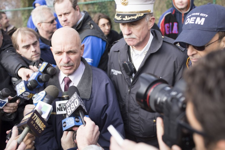 Fire Department of New York (FDNY) Commissioner Salvatore Cassano (left) speaks to the media after Metro-North train derailed near the Spuyten Duyvil station December 1, 2013 in the Bronx borough of New York City. Multiple injuries and several deaths were reported after the seven car train left the tracks as it was heading to Grand Central Terminal along the Hudson River line. (Christopher Gregory/Getty Images)
