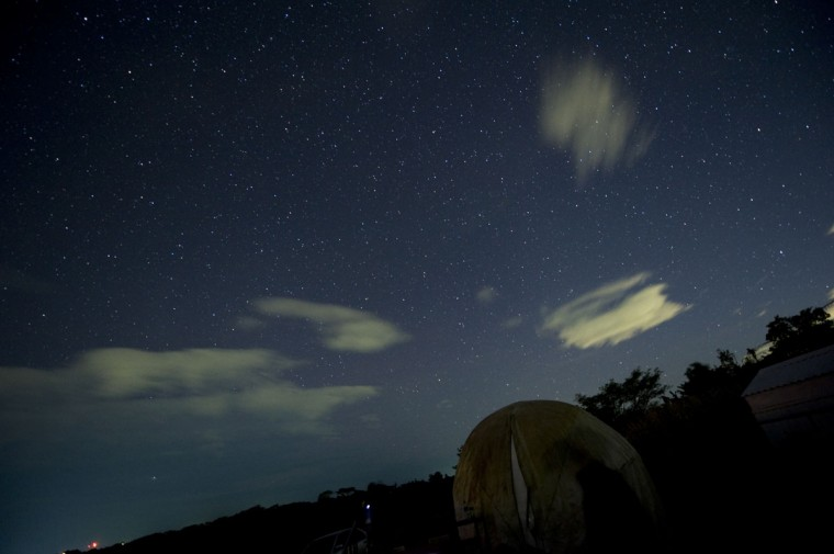 """This general view shows the Geminids meteor shower from the Prudencio Llach observatory in San Juan Talpa, 40 kms south of San Salvador on December 13, 2012. The US space agency NASA said on December 10 that the best meteor shower of the year, a display of shooting stars known as the Geminids, began on December 7 and was set to peak early on December 11, lasting for several days. The annual Geminids meteor shower was first glimpsed late in the 19th century, but at that time """"the shower was weak and attracted little attention"""". (Jose Cabezas/AFP/Getty Images)"""