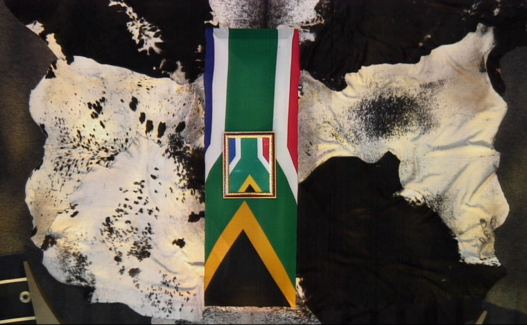 A screengrab taken from the South African Broadcasting Corporation live feed shows the coffin of late South African President Nelson Mandela draped in a South African flag during the funeral service in his childhood village of Qunu on December 15, 2013. Mandela will be buried near the homestead, ending 10 days of national mourning and global tributes for the prisoner-turned-president who transformed his country and inspired the world. (AFP/Getty Images)